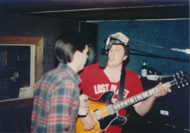My father, Dave, singing with his friend Paul.