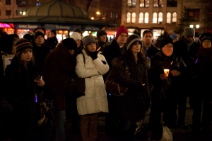 People gather for a candlelight vigil for the victims of the 2011 Tucson, Arizona, shooting that killed six people and left Congresswoman Gabrielle Giffords critically injured. The shooting prompted some lawmakers to call for a re-examination of the country's gun laws.