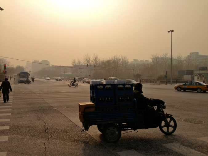 The light from the sun against the pollution sometimes casts a yellow tint over Beijing.