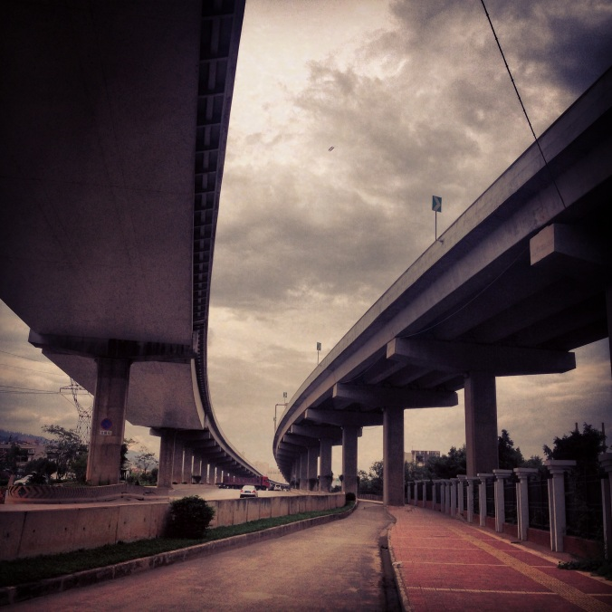 I rented a bike in Kunming and rode out into the countryside. The route under this overpass was pretty dangerous, with large trucks carrying steel pipes, coal and large vehicles sometimes cutting through the bike lane.