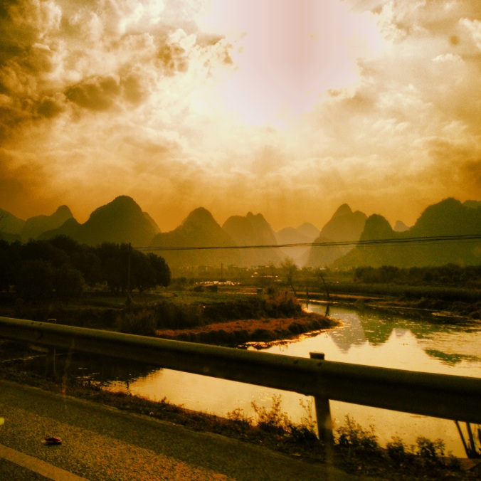 In a cab, somewhere between Guilin and Yangshuo.