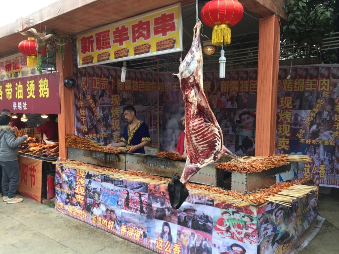 Vendors from western China's Xinjiang Uyghur Autonomous Region sell lamb skewers at the temple fair.
