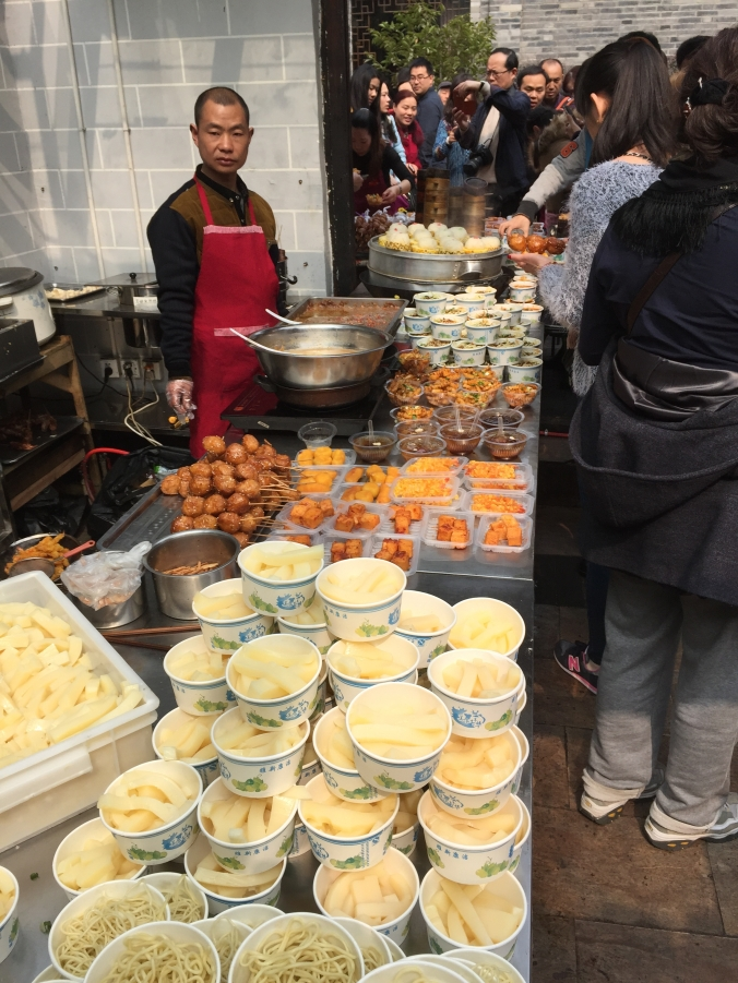Chengdu is well know for its street food. Here, a vendor sells snacks at a restaurant on Jinli Pedestrian Street, a popular tourist site.