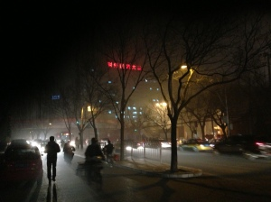 At night, the air pollution, illuminated by street and car lights, resembled a thick fog.
